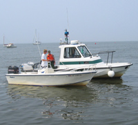 Park ranger boat beside other boat, as ranger conducts a vessel safety check.