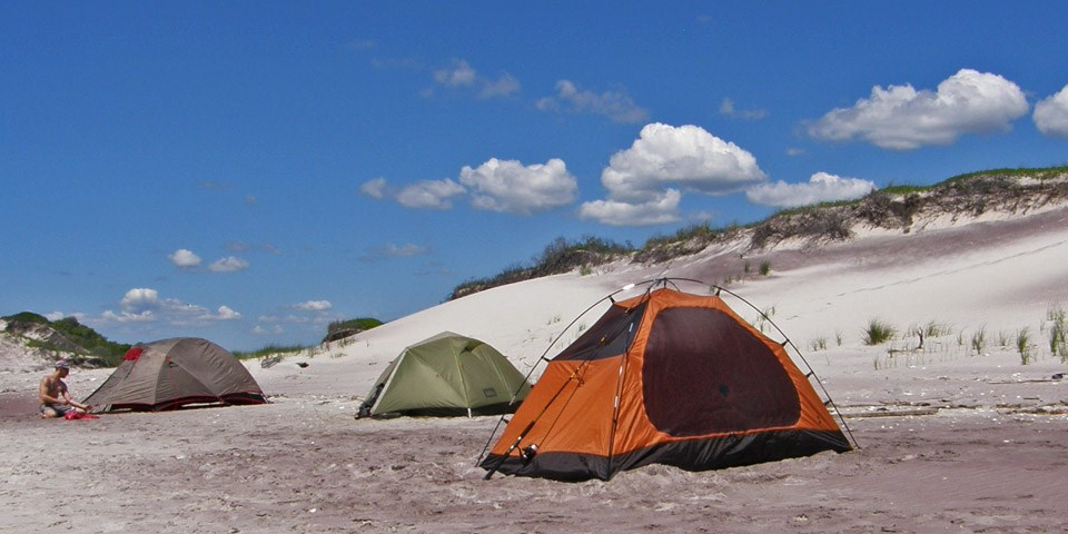 Camping tents along the dunes.