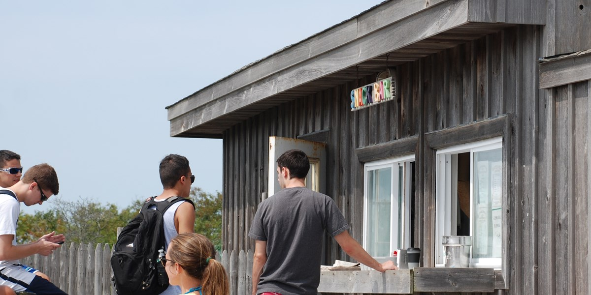 Visitors order food at the Watch Hill Snack Bar