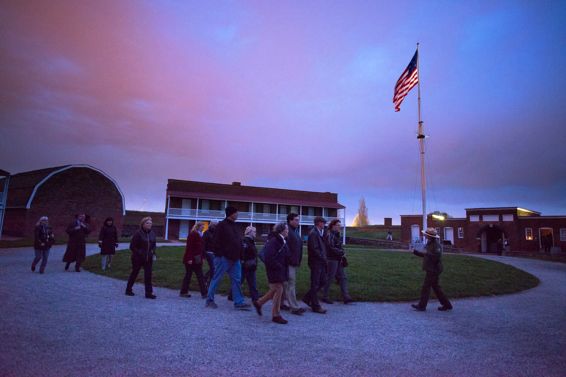 Park Ranger guiding visitors through the Star Fort during a candlelight tour.