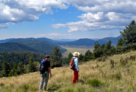 Photo of hikers on the Cerro Grande Trail at Bandelier National Monument.