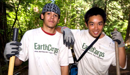 Two volunteers on a trail work project
