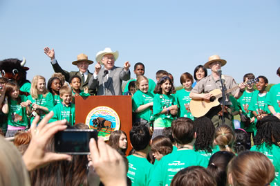 Ranger Jeff on stage with Secretary of Interior and Director of the National Park Service and lots of kids