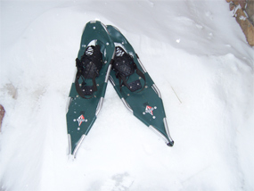 A pair of snowshoes in a snow drift