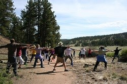 Visitors doing yoga exercise during hike