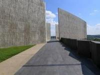 Long black walkway and tall gray walls