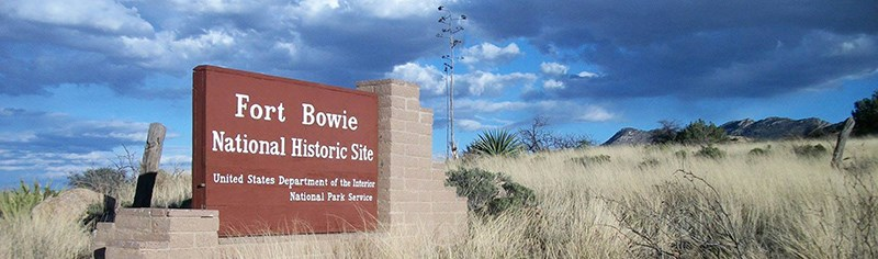 Entrance sign in grassland at Fort Bowie National Historic Site