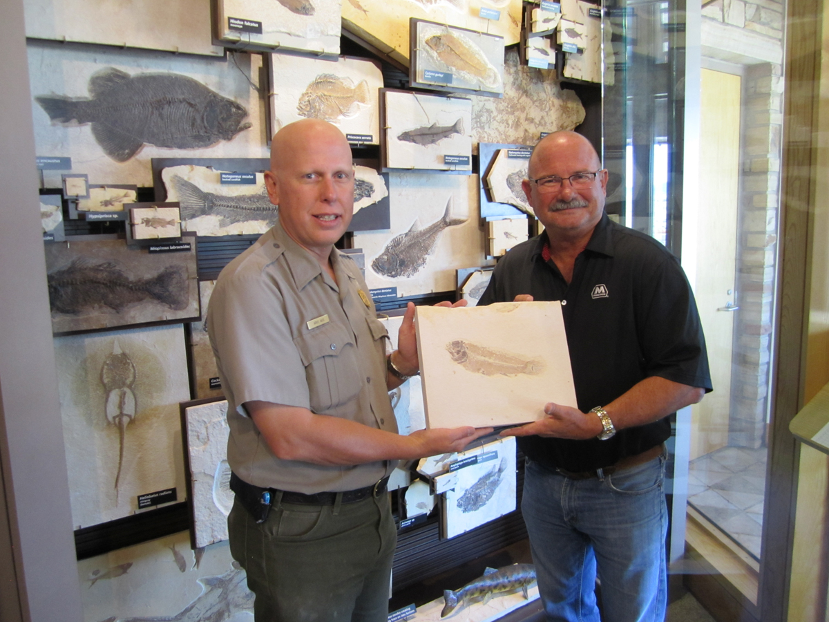 Arvid Aase and Philip Frasier hold fossil bowfin