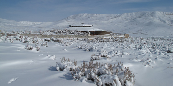 visitor center with Fossil Butte in background in snow