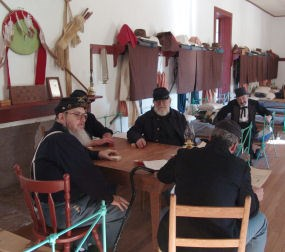 Reenactors in the enlisted men's barracks.