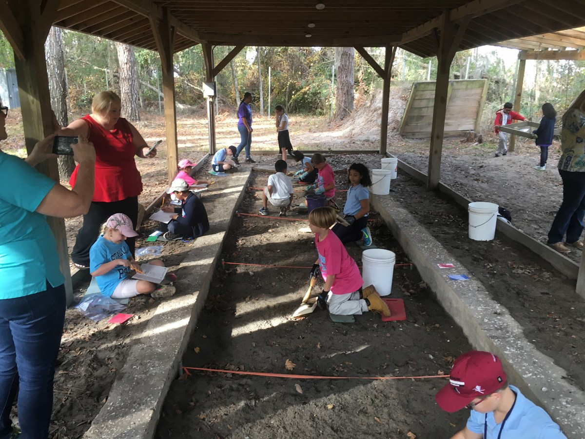 kids working on archeology