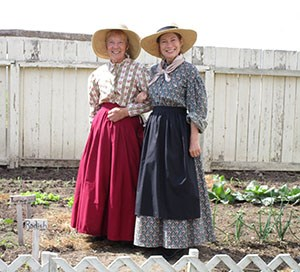 Photo of two women in 19th century clothing.