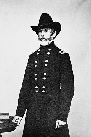 Man with beard in Civil War officers' uniform.