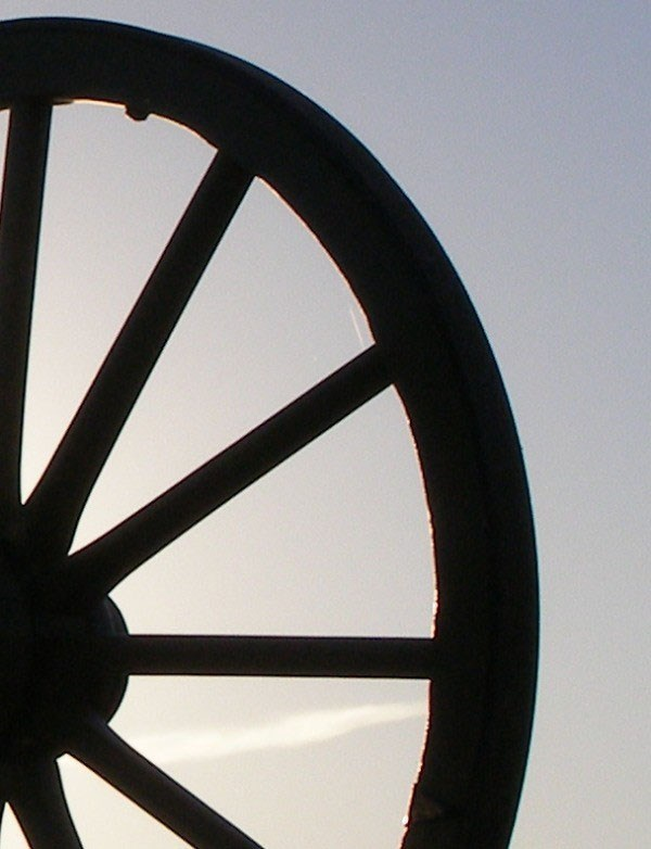 Close up view of a partial wagon wheel.