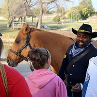 Buffalo Soldier re-enactor talks with the public.