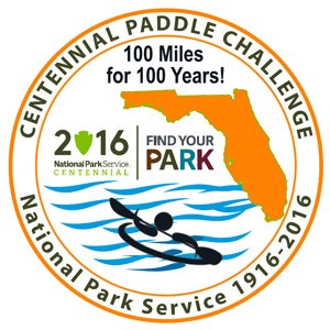 Round patch featuring a styalized kayaker on blue water with an outline of the State of Florida and the National Park Service's Centennial Logos