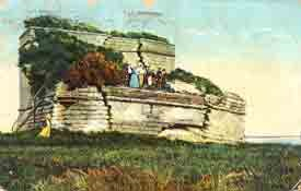 An old post card of Fort matanzas with tourists in long dresses.
