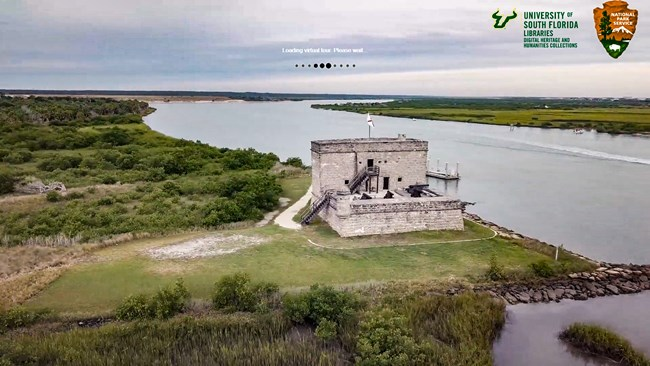 flyover image of fort matanzas used as a splash screen for the virtual tour USF and NPS Arrowhead are located in the top right hand corner in the center of the screen a loading icon