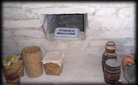The powder magazine kept the gunpowder safe and dry behind thick walls.