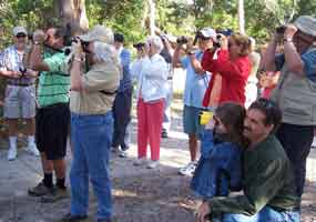 People of all ages enjoying a bird walk at Fort Matanzas National Monument.