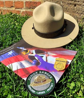 Fort McHenry Junior Ranger activity book, badge, patch, and park ranger flat hat