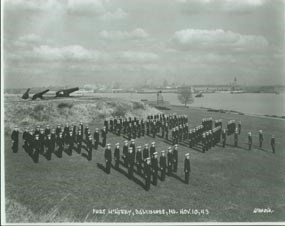 Men standing for inspection at the U.S. Coast Guard Training Station.