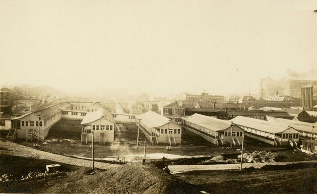 A black and white photograph showing large buildings that were constructed for the hospital.