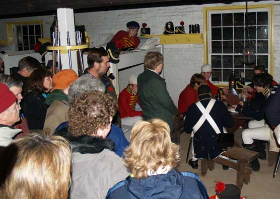 Visitors learn about yuletide activities within a fort.