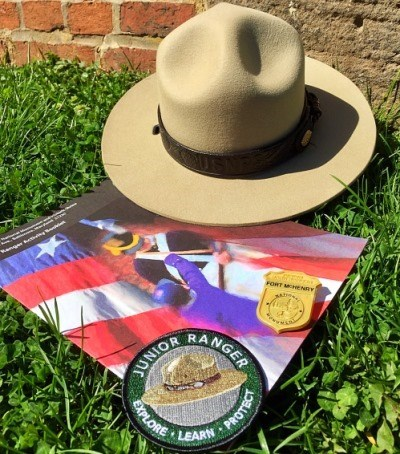 Junior Ranger booklet, badge, patch, and park ranger hat.