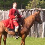 Photograph of an actor portraying George Washington on a horse