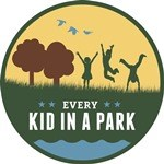Every Kid in a Park Logo of three children playing outside