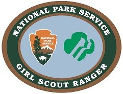 A patch with the National Park Service Arrowhead logo and the Girl Scout logo.