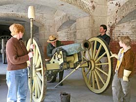 Canon loading demonstration showing ranger behind cannon and audience helpers