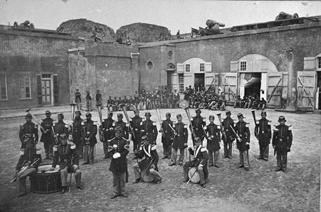 48th NY Vol. Infantry band in front of northwest bastion and stairwell, ca. 1862.