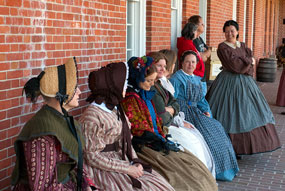 19th-century lkiving historians portraying the  wives of the 48th New York Infantry Regiment.