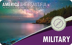 Front of the Military Annual Pass has text and an image shwoing a lake shore at night.