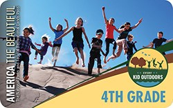 Front of the 2019-20 4th Grade Pass depicts nine children leaping down a sand dune.