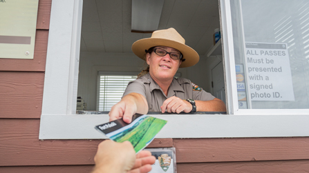 A park ranger welcomes you to Fort Pulaski with a park brochure.