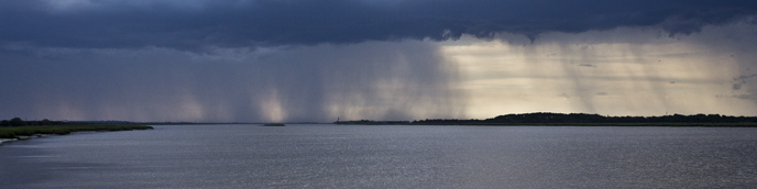 A thunderstorm approaches Cockspur Island.