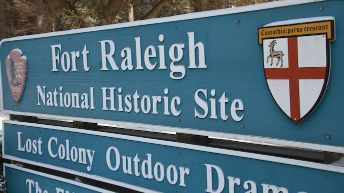 Snow-dusted Fort Raleigh National Historic Site entrance sign