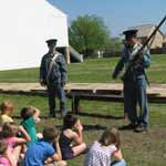 Presenters demonstrating weapons during Life on the Frontier program