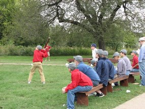 Youth playing a Civil War era ballgame