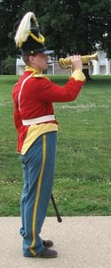 Dragoon bugler calling troops together,