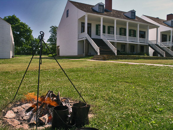 Fire with cooking utensils at Fort Scott