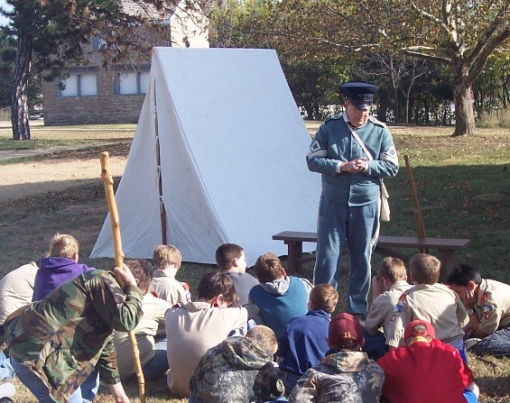 Infantry soldier presenting station to a scout group