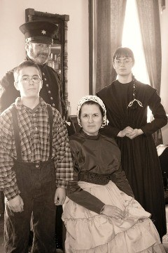 Reenactors portraying an officer, his wife and their children