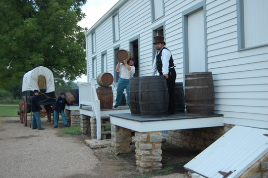 FSNHS staff and volunteers recreate a scene at the quartermaster storehouse.