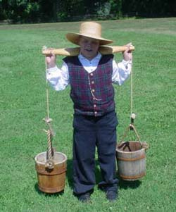 Child with yoke and buckets