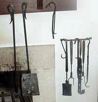 Fireplace tools from left to right. Poker, Ash Shovel, Pothooks, Spatula, Meat Fork, Trammel, Meat Fork