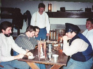 Soldiers playing checkers in the aquad room.